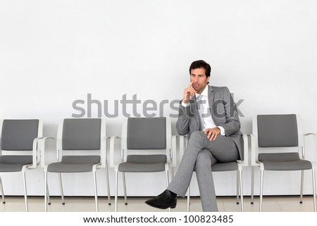 Businessman sitting in airport waiting room