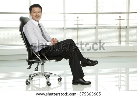 Businessman Sitting in Chair - stock photo