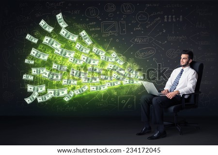 Businessman sitting in chair holding laptop with dollar bills coming out concept on background - stock photo