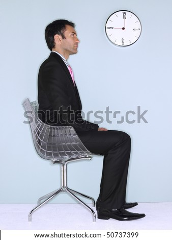 person sitting in chair stock images royaltyfree images