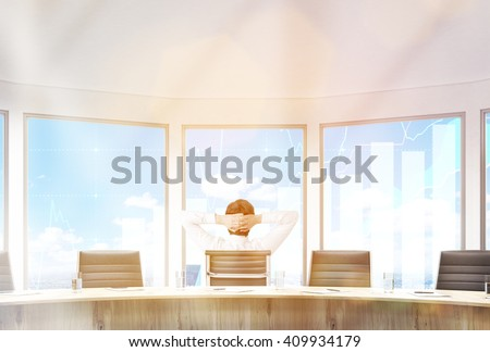 Businessman sitting in conference room with hands on head. Large windows with business graphs. 3D Rendering - stock photo