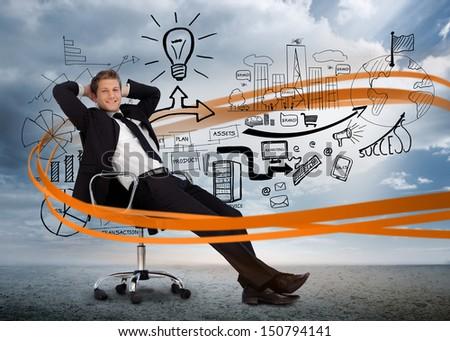 Businessman sitting in front of detailed brainstorm with orange swirl in desert landscape - stock photo