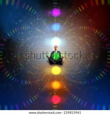 Businessman sitting in lotus flower position against zen background - stock photo