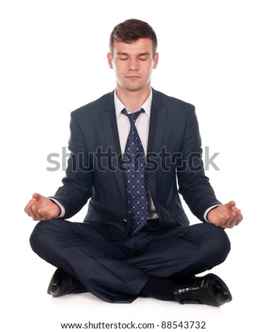 Businessman sitting in lotus position isolated on white background