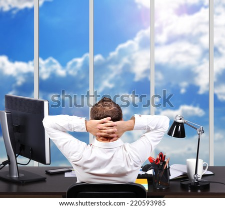 businessman sitting in office and looking to window - stock photo