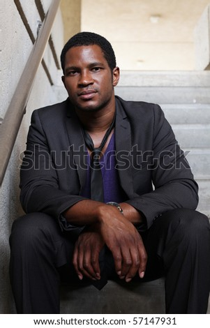 Businessman sitting in Stairwell - stock photo
