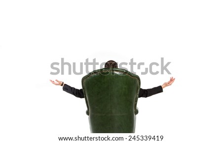 Businessman sitting in the big chair. Man in a chair with his back turned and opened his arms in different directions. Only visible hand. Waiting for the miracle business. View from the back. - stock photo
