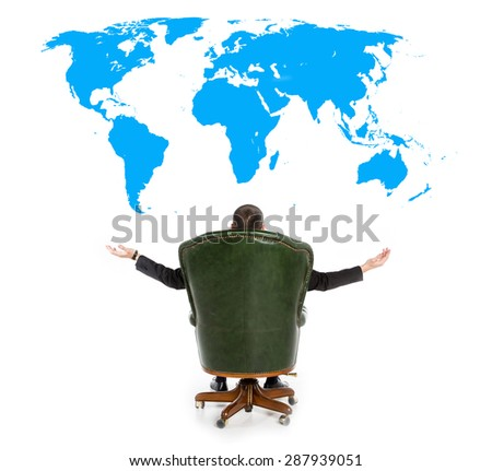 Businessman sitting in the big chair. Man in a chair with his back turned and opened his arms in different directions. Waiting for the miracle business. View from the back. Man on world map background - stock photo