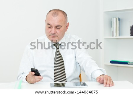Businessman  sitting in the office and typing message. - stock photo
