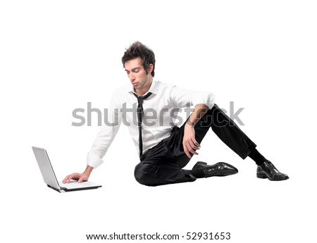 Businessman sitting next to a laptop