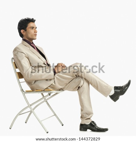 Businessman sitting on a chair - stock photo