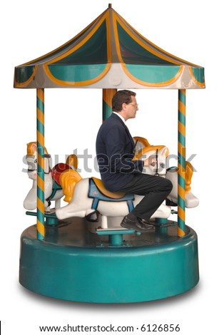 Businessman sitting on a small merry-g0-round ride on a white background - stock photo