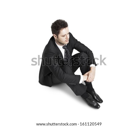 businessman sitting  on a white background