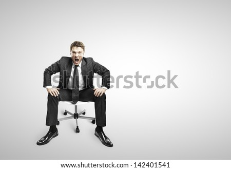 businessman sitting on chair and screaming on a white background