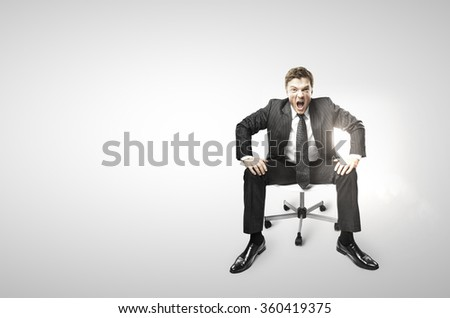 businessman sitting on chair and screaming on a white background - stock photo