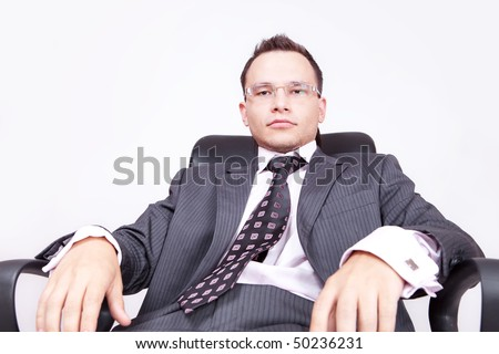 businessman sitting on chair look at you