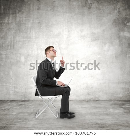 businessman sitting on chair with laptop