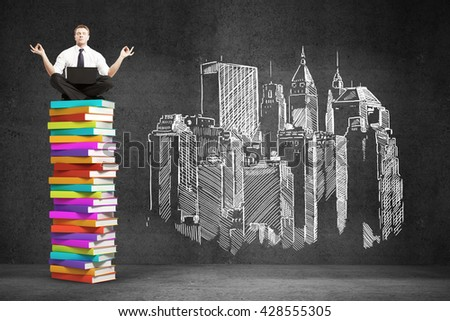Businessman sitting on colorful book stack. Drawing city on concrete wall. 3D Rendering - stock photo