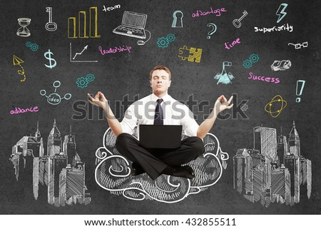 businessman sitting on drawing cloud with laptop and  meditating - stock photo