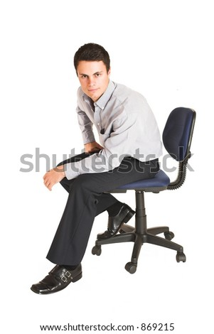 Businessman sitting on office chair.