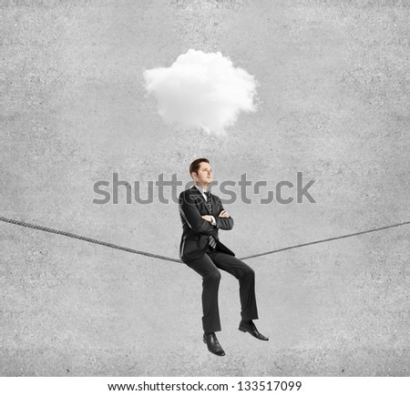 businessman sitting on rope and cloud