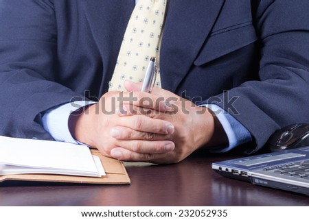 businessman sitting on the desk in office