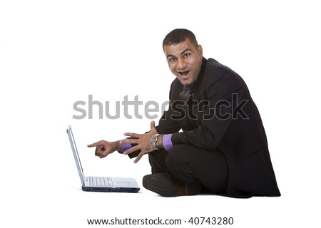 Businessman sitting on the floor and is suprised what he found on the internet. Isolated on white background. - stock photo