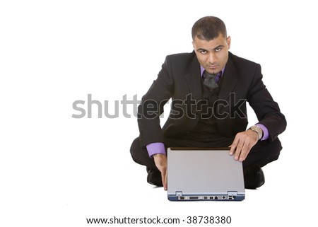 Businessman sitting on the floor and opens his laptop. Isolated on white background. - stock photo