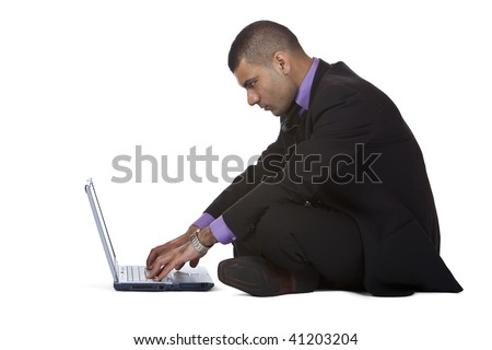 Businessman sitting on the floor and works with his laptop. Isolated on white background. - stock photo