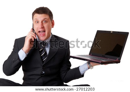 Businessman sitting on the floor is screaming on his mobile phone