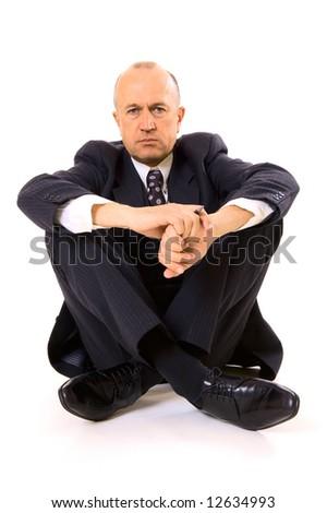 businessman sitting on the floor. isolated on white