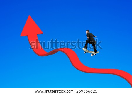 Businessman skateboarding on red arrow up bending trend line with blue background