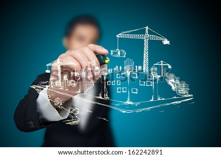Businessman sketching a construction project. - stock photo