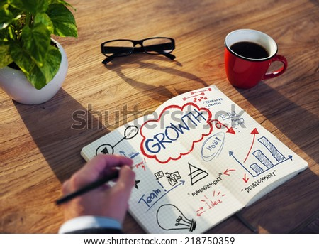 Businessman Sketching About Growth Concept - stock photo