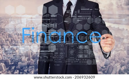 Businessman sketching and writing Finance with nice business city background in retro colors.  - stock photo