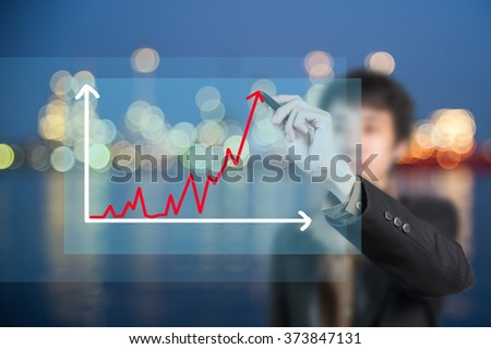 Businessman sketching diagram of changes of market, Oil Refinery background - stock photo