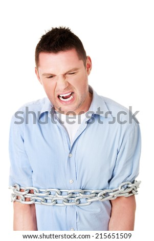 Businessman slave tied up with chain - stock photo