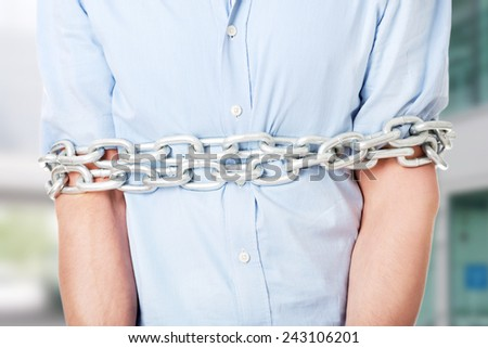 Businessman slave tied up with chain