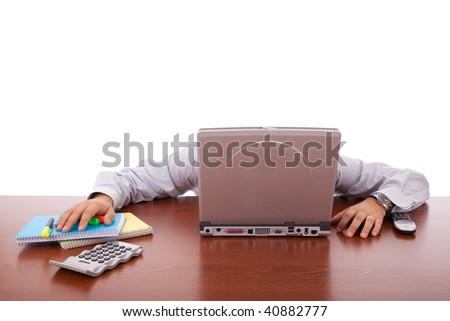 businessman sleeping behind his laptop - stock photo