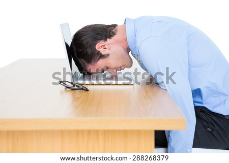 businessman sleeping head on laptop against a white screen