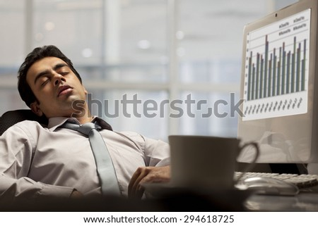 Businessman sleeping in the office - stock photo