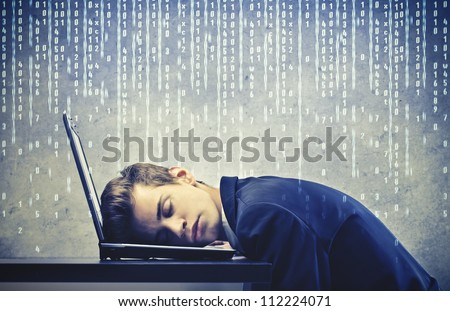 Businessman sleeping on his laptop - stock photo