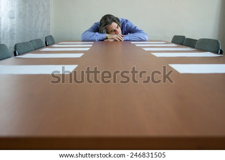 businessman sleeping on table in office - stock photo