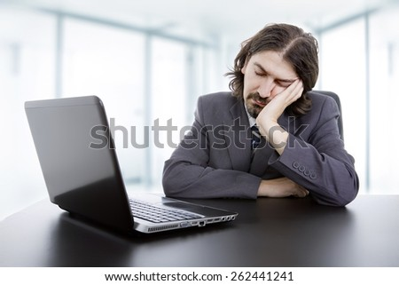 businessman sleeping on the laptop, at the office - stock photo