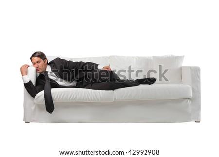 businessman sleeping on the sofa - stock photo