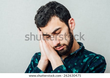 Businessman sleeping over gray background - stock photo