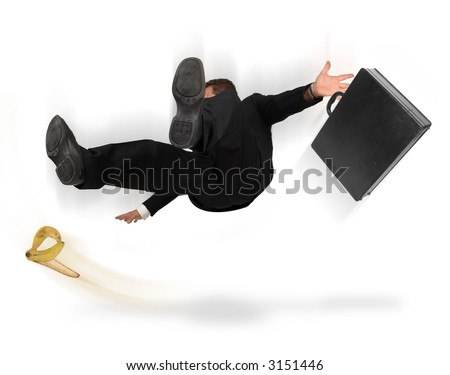 Businessman slipping and falling from a banana peel on a white background - stock photo