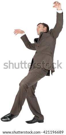 Businessman slipping on banana peel isolated on white background - stock photo