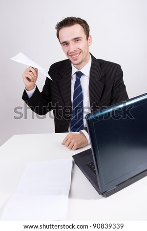 Businessman smile portrait in office, teacher or student with computer, laptop, fashion male model, man with paper airplane toy, studio shot on  bright background - stock photo