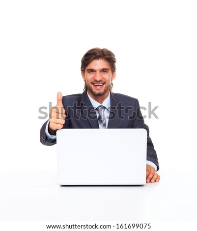 businessman smile show thumb up finger gesture, working using laptop computer, handsome young businessman sitting at the desk wear elegant suit, isolated over white background - stock photo